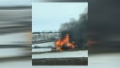 A vehicle was engulfed in flames on the off-ramp from eastbound Glenmore Trail to northbound Deerfoot Trail on Friday afternoon (image: Nicole Hippe)