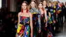 Models take the catwalk during the Versace women's Fall/Winter 2018-2019 collection, presented during the Milan Fashion Week, in Milan, Italy, Friday, Feb. 23, 2018. (AP Photo/Antonio Calanni)
