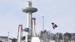 Sebastien Toutant of Canada takes a training jump prior to the men's snowboard big air final at the 2018 Winter Olympic Games in Pyeongchang, South Korea, Saturday, Feb. 24, 2018. (THE CANADIAN PRESS / Jonathan Hayward)