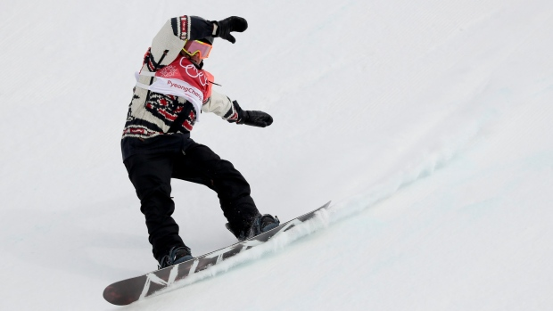 Sebastien Toutant, of Canada, lands during the men's Big Air snowboard competition at the 2018 Winter Olympics in Pyeongchang, South Korea, Saturday, Feb. 24, 2018. (AP Photo/Kirsty Wigglesworth)