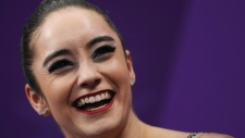 Kaetlyn Osmond of Canada reacts as her scores are posted following her performance in the women's free figure skating final in the Gangneung Ice Arena at the 2018 Winter Olympics in Gangneung, South Korea, Friday, Feb. 23, 2018. (AP Photo/Bernat Armangue)