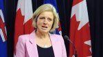 Alberta Premier Rachel Notley announces that she is suspending the province's ban on B.C. wine at the legislature in Edmonton, on Thursday, February 22, 2018. (THE CANADIAN PRESS/Dean Bennett)