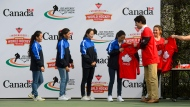Prime Minister Justin Trudeau, wife, Sophie Gregoire Trudeau take part in a hockey event with Hayley Wickenheiser and the Indian women's national ice hockey team at the Canadian High Commission of Canada in New Delhi, India on Saturday, Feb. 24, 2018. THE CANADIAN PRESS/Sean Kilpatrick