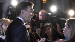 Minister of Finance Bill Morneau speaks to reporters after leaving a cabinet meeting on Parliament Hill in Ottawa on February 6, 2018. (THE CANADIAN PRESS/Justin Tang)