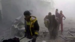 This frame grab from video released on Saturday, Feb 24, 2018 by the Syrian Civil Defense group known as the White Helmets, shows members of the Syrian Civil Defense group help residents during airstrikes and shelling by Syrian government forces, in Ghouta, a suburb of Damascus, Syria. (Syrian Civil Defense White Helmets via AP)