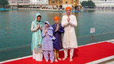 Prime Minister Justin Trudeau, right, his wife Sophie Gregoire Trudeau, left, their daughter Ella Grace, second left, and son Xavier greet in Indian style during their visit to Golden Temple, in Amritsar, India, Wednesday, Feb. 21, 2018. Trudeau is on a seven-day visit to India. (Public Relations Office Govt. Of Punjab via AP)