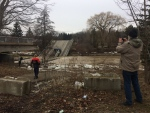 Onlookers arrived with cameras at the site of a collapsed bridge in Port Bruce on Saturday, Feb. 24, 2018.