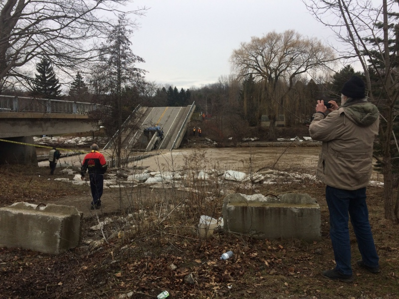 Onlookers arrived with cameras at the site of a collapsed bridge in Port Bruce on Saturday, Feb. 24, 2018. (Brent Lale / CTV London)