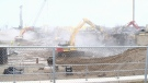 Excavators start to tear down the Victoria Street bridge over the Conestoga Expressway on Feb. 24, 2018 (CTV Kitchener)