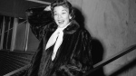 FILE - In this Dec. 10, 1955 file photo, actress Nanette Fabray poses as she leaves Mt. Sinai hospital in New York. Fabray, the vivacious, award-winning star of the stage, film and television, has died at age 97. (AP Photo/File)
