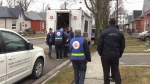 A group of volunteers with the Salvation Army go door to door handing out essentials to those affected by the flood waters in Brantford on Feb. 24, 2018 (CTV Kitchener)
