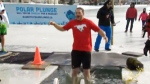 Raising money for Special Olympics with a polar plunge into Arbour Lake.