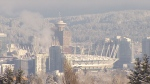 A snowy downtown Vancouver is seen from Queen Elizabeth Park on Feb. 24, 2018.