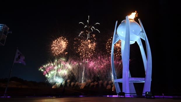 Fireworks explode behind the Olympic cauldron at the start of the closing ceremony of the 2018 Winter Olympics in Pyeongchang, South Korea, Sunday, Feb. 25, 2018. (Christof Stache/Pool Photo via AP)