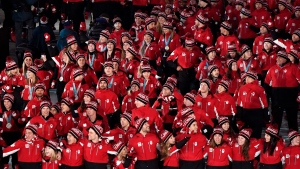 Canadian athletes enter the stadium during the closing ceremonies at the 2018 Pyeongchang Olympic Winter Games in Pyeongchang, South Korea, on Sunday, February 25, 2018. (THE CANADIAN PRESS/Paul Chiasson)