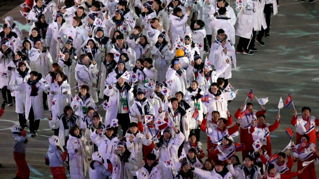 North Korean athletes, bottom right, walk ahead of South Korean athletes as they march into the stadium during the closing ceremony of the 2018 Winter Olympics in Pyeongchang, South Korea, Sunday, Feb. 25, 2018. (AP Photo/Aaron Favila)