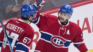 Montreal Canadiens' captain Max Pacioretty (67) celebrates with teammate Tomas Plekanec after scoring on the Ottawa Senators during first period NHL hockey action, in Montreal, on Saturday, Dec. 12, 2015. (THE CANADIAN PRESS/Graham Hughes)