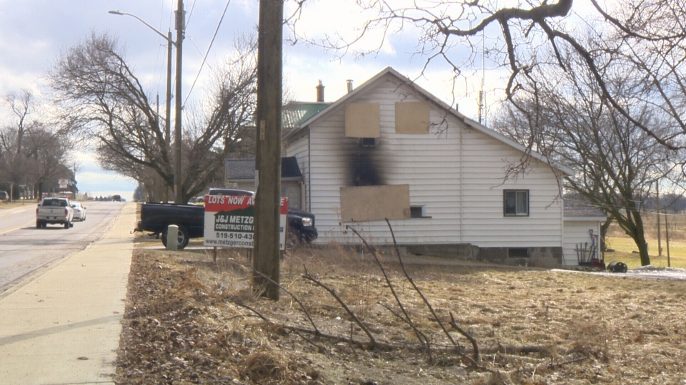 A house on Elora Street in Harriston is seen with the windows boarded up and smoke damage on the siding on Feb. 25, 2018 (CTV Kitchener)