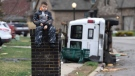 Gio Rodriguez, 8, sits outside his home as his parents clean up debris Sunday morning after a fierce storm hit Saturday, Feb. 24, 2018, in the Farmington subdivision in Clarksville, Tenn. (Lacy Atkins/The Tennessean via AP)