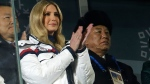 Ivanka Trump, U.S. President Donald Trump's daughter, applauds during the closing ceremony in Pyeongchang, South Korea, Sunday, Feb. 25, 2018. At rear right is Kim Yong Chol, vice chairman of North Korea's ruling Workers' Party Central Committee. (AP Photo/Natacha Pisarenko)