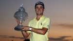 Justin Thomas holds up his trophy after winning the Honda Classic golf tournament in a sudden-death playoff Sunday, Feb. 25, 2018, in Palm Beach Gardens, Fla. (AP Photo/Wilfredo Lee)