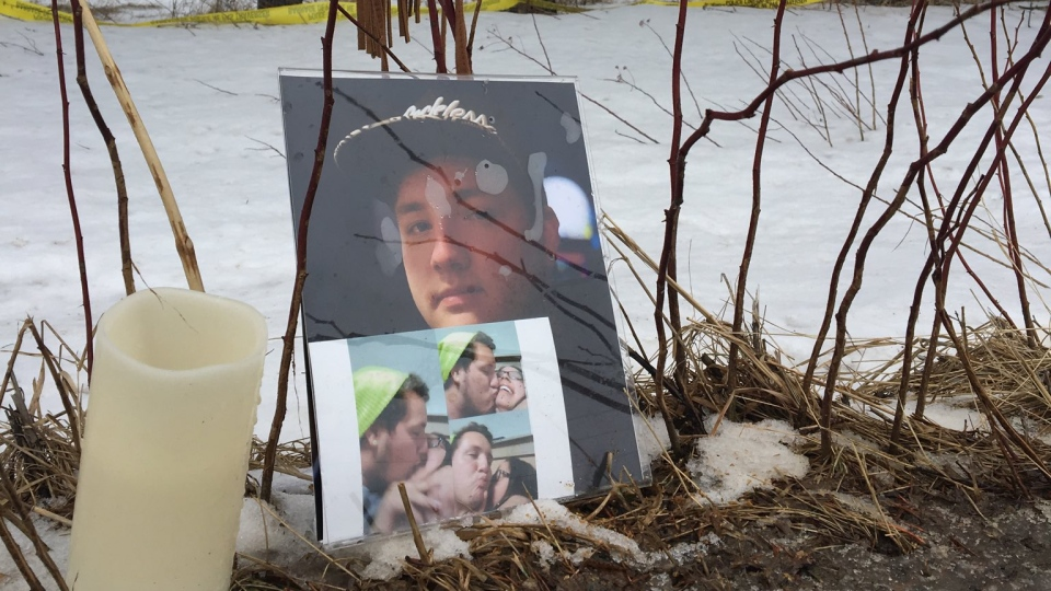 A roadside memorial for Brady Francis is seen at the site where the 22-year-old man was struck and killed by a vehicle in Saint-Charles, N.B.