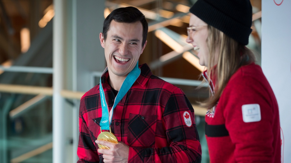 Olympic gold medalists, figure skater Patrick Chan, left, of Toronto, and freestyle skier Cassie Sharpe, of Comox, B.C., share a laugh after arriving from South Korea at Vancouver International Airport in Richmond, B.C., on Monday February 26, 2018. (THE CANADIAN PRESS/Darryl Dyck)