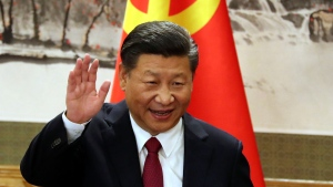 In this Oct. 25, 2017, file photo, Chinese President Xi Jinping waves while addressing the media as he introduced new members of the Politburo Standing Committee at Beijing's Great Hall of the People. (AP Photo/Ng Han Guan, File)