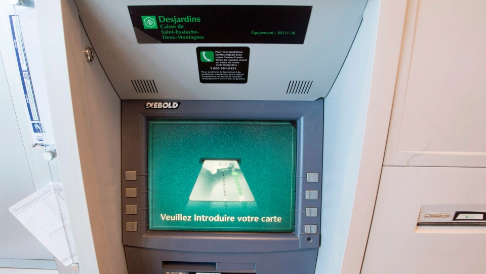 A Caisse Desjardins ATM is seen Tuesday, February 27, 2018 in Montreal. Desjardins has announced plans to close dozens of ATMs in outlying regions of the province. THE CANADIAN PRESS/Ryan Remiorz