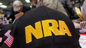 In this March 7, 2012 file photo, Illinois gun owners and supporters file out National Rifle Association applications while participating in an Illinois Gun Owners Lobby Day convention before marching to the Illinois state Capitol in Springfield, Ill. (Seth Perlman / AP)