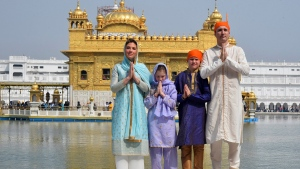 Canadian Prime Minister Justin Trudeau, right, his wife Sophie Gregoire Trudeau, left, their daughter Ella Grace, second left, and son Xavier greet in Indian style during their visit to Golden Temple, in Amritsar, India, Wednesday, Feb. 21, 2018. (Public Relations Office Govt. Of Punjab via AP)