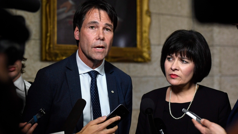 Minister of Health Ginette Petitpas Taylor stands with Eric Hoskins, former Ontario Minister of Health, after the tabling of the budget in the House of Commons on Parliament Hill in Ottawa on Tuesday, Feb. 27, 2018. (Justin Tang/THE CANADIAN PRESS)
