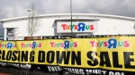 In this Feb. 27, 2018 file photo, a branch of Toys R Us at St Andrews retail park in Birmingham, England, displays a closing down sale banner. (Aaron Chown/PA via AP, File)