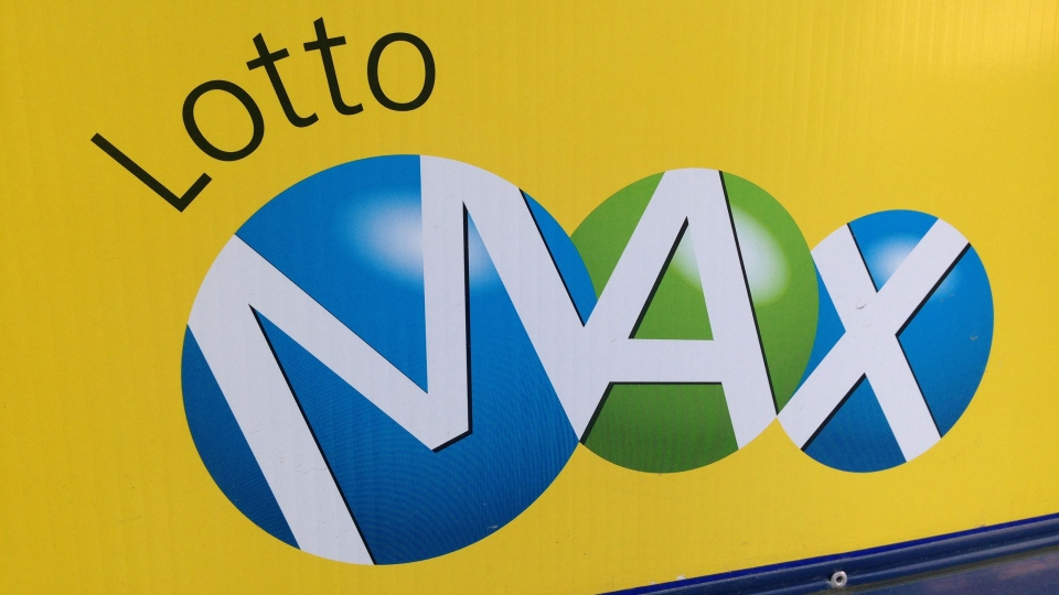 A sign outside a Toronto convenience store advertises a Lotto Max draw. (Chris Kitching/CP24)
