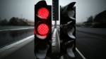 Red lights are covered with snow before a Formula One pre-season testing session at the Catalunya racetrack in Montmelo, Spain, on Feb. 28, 2018. (Manu Fernandez / AP)