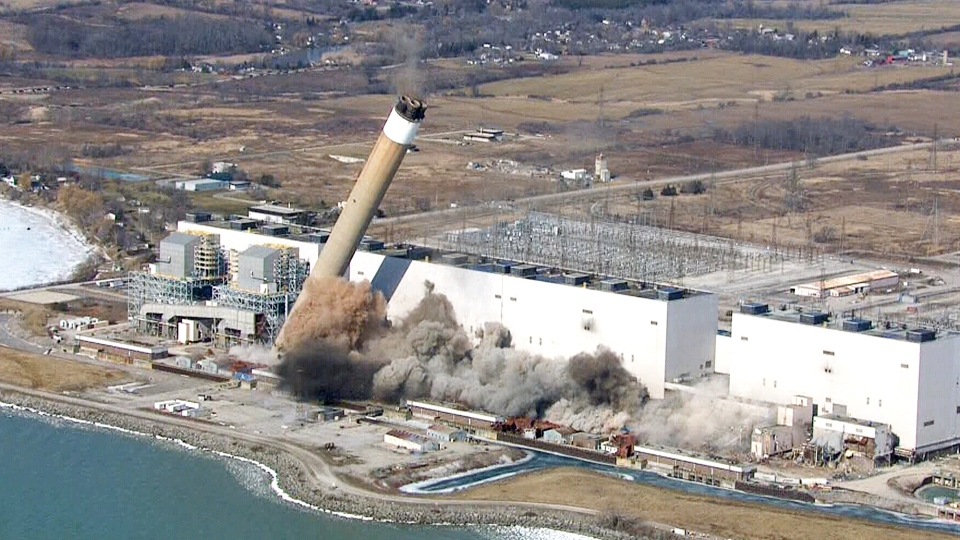 Smoke and dust are seen after two giant chimneys at the Nanticoke generating station were toppled, Wednesday, Feb. 28, 2018.