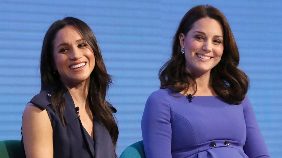 Kate, Duchess of Cambridge, right, and Meghan Markle attend the first annual Royal Foundation Forum in London, Wednesday Feb. 28, 2018. (Chris Jackson/Pool via AP)