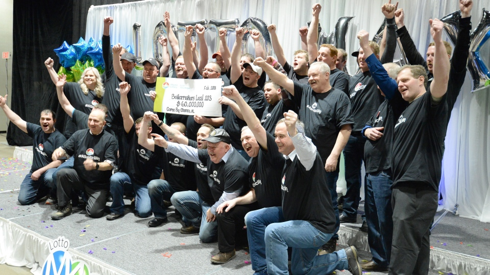 Thirty-one members of the Boilermakers Local 203 at the North Atlantic oil refinery in Come By Chance, N.L., collected their shares of a $60 million Lotto Max jackpot Wednesday in St. John's. (THE CANADIAN PRESS/Keith Gosse)
