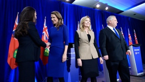 Ontario PC leadership candidates Tanya Granic Allen and Caroline Mulroney shake hands as Christine Elliott and Doug Ford leave the stage following a debate in Ottawa on Wednesday, Feb. 28, 2018. THE CANADIAN PRESS/Justin Tang