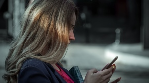 A woman looks at her phone in this file photo. (Pexels)