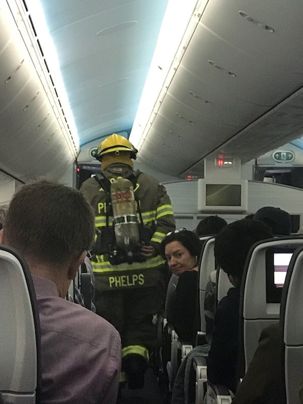 Fire crews respond to a fire caused by a cellphone on an Air Canada flight at Toronto's Pearson Airport on March 1, 2018.