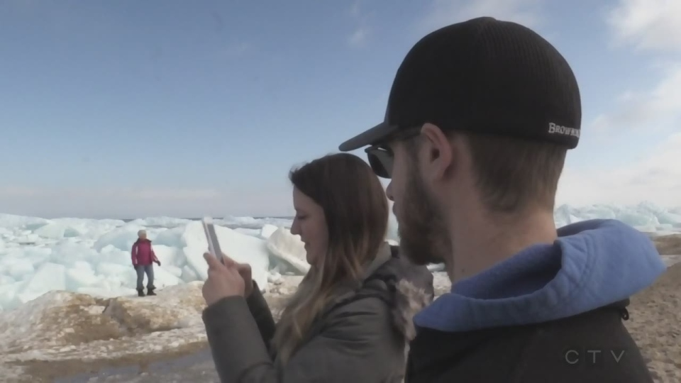 Amateur photographers are drawn to the blue ice