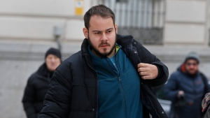 In this Feb. 1, 2018. file photo, Rap singer Pablo Rivadulla arrives at the National court in Madrid, Spain. (AP Photo/Paul White)