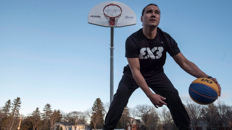 Michael Linklater poses for a photograph at an outdoor basketball court near his home in Saskatoon on Tuesday,October 24,2017. (THE CANADIAN PRESS/Liam Richards)