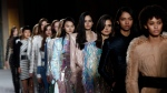 Models wear creations for Balmain's ready-to-wear fall-winter 2018/2019 fashion collection presented in Paris. (AP Photo / Thibault Camus)