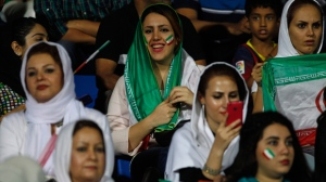 In this Sept. 8, 2015 file photo, Iranian women watch the 2018 FIFA World Cup qualifying soccer match between Iran and India in Bangalore, India. (AP Photo/Aijaz Rahi)