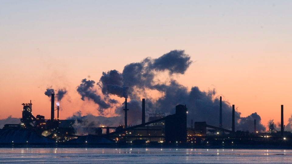 Steel plants are seen across the bay at sunrise in Hamilton, Ont. Wednesday Feb. 7, 2007 (CP PHOTO/Adrian Wyld)
