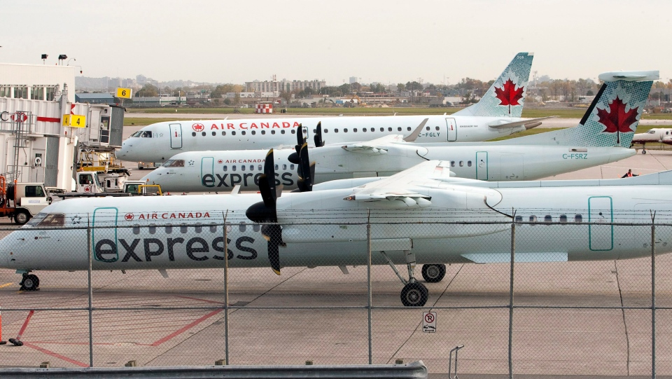 Air Canada planes line up at the terminal at Pierre Elliott Trudeau Airport on Wednesday, October 12, 2011 in Montreal. THE CANADIAN PRESS/Ryan Remiorz