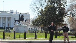 Law enforcement officers at Lafayette Park across from the White House in Washington, take up positions as they close the area to pedestrian traffic, Saturday, March 3, 2018. (AP Photo/Pablo Martinez Monsivais)