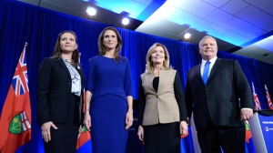 Ontario PC leadership candidates Tanya Granic Allen, Caroline Mulroney, Christine Elliott and Doug Ford pose for a photo after participating in a debate in Ottawa on Wednesday, Feb. 28, 2018. Ontario's Progressive Conservative party is giving members even more time to sign up to cast their vote for a new leader.THE CANADIAN PRESS/Justin Tang